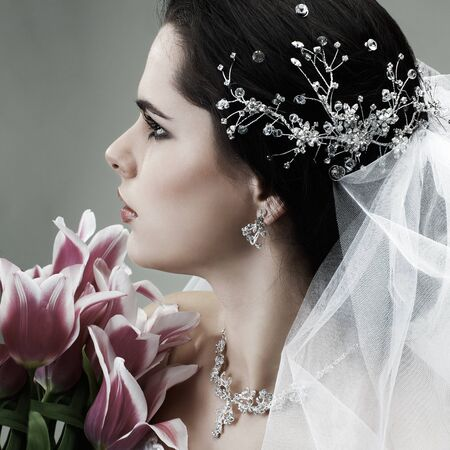 A brunette is beautiful in a wedding-dress, wedding decoration photo