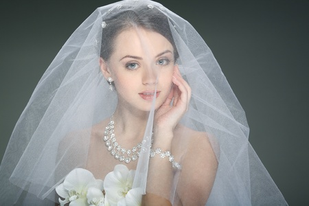 veil: A beautiful young girl is in a wedding decoration