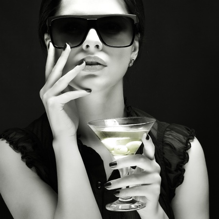 beautiful young girl  with  glass of martini Stock Photo