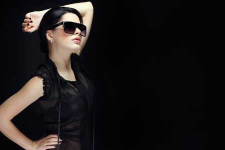 elegant sexual woman in black  clothes in fashion style Stock Photo - 13292633
