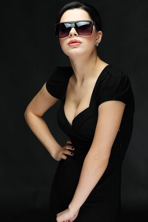 elegant sexual woman in black  clothes in fashion style photo