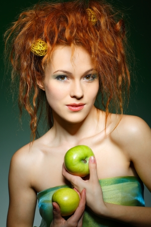Portrait of beautiful sexual redheaded girl with apples Stock Photo - 13622685