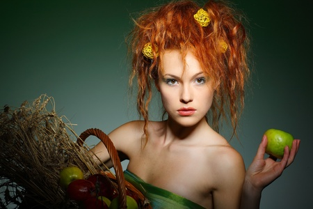 Portrait of beautiful sexual redheaded girl with apples photo