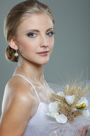 A beautiful sexual bride is in a wedding-dress, wedding decoration photo