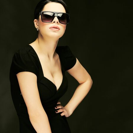 elegant sexual woman in black  clothes in fashion style Stock Photo - 14297307