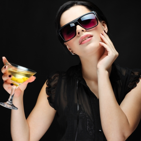 beautiful young girl  with  glass of martini photo