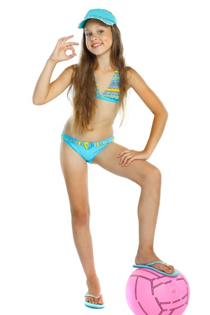 swimsuit: cute little girl in swimming suit with a ball, isolated on a white background