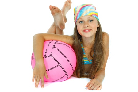 innocent girl: cute little girl in swimming suit with a ball, isolated on a white background