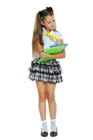 schoolgirls: a little girl is in a school form which had an idea, isolated on a white background