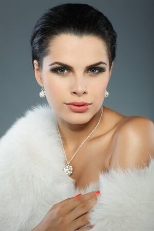 A sexual beautiful girl is in fur clothes photo