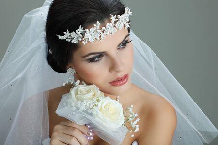 wedding accessories: Portrait of beautiful bride. Wedding dress. Wedding decoration