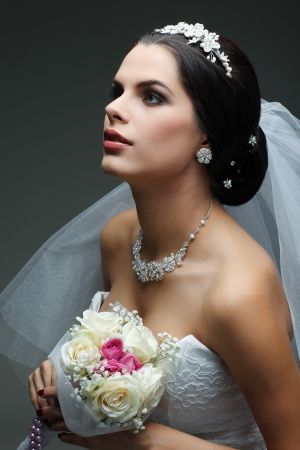 wedding accessories: Portrait of beautiful bride. Wedding dress. Wedding decoration