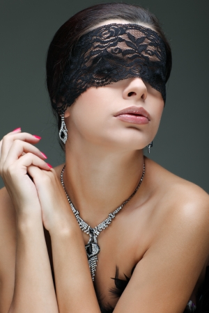 portrait elegant sexual  brunette woman is in a black lace mask Stock Photo - 15636103