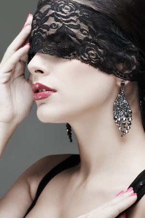 portrait elegant sexual  brunette woman is in a black lace mask Stock Photo - 15636093