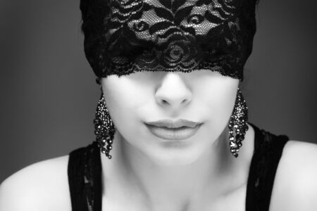 portrait elegant sexual  brunette woman is in a black lace mask Stock Photo - 15636087