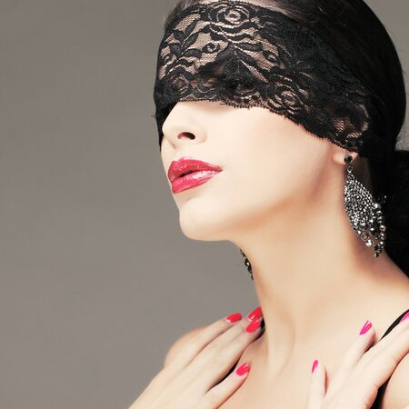 portrait elegant sexual  brunette woman is in a black lace mask Stock Photo - 15636100