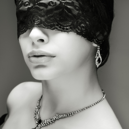 portrait elegant sexual  brunette woman is in a black lace mask Stock Photo - 16861568