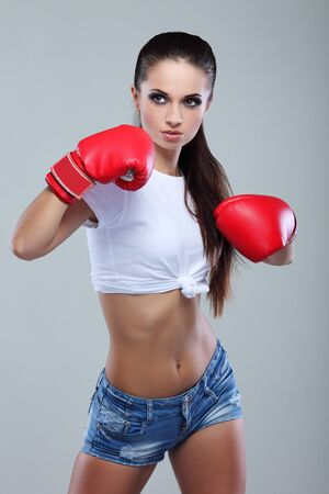 boxer shorts: Beautiful sexual boxing girl, fitness, on a grey background
