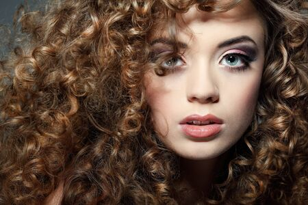 Young beautiful woman with long curly hairs Stock Photo - 17501604
