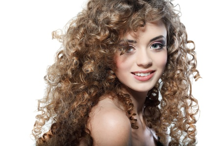 Young beautiful woman with long curly hairs photo