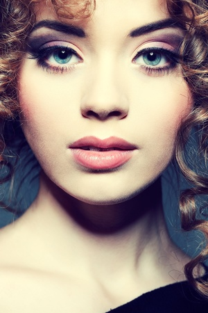 Young beautiful woman with long curly hairs Stock Photo - 17501626