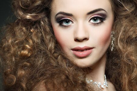 Young beautiful woman with long curly hairs Stock Photo - 17501601