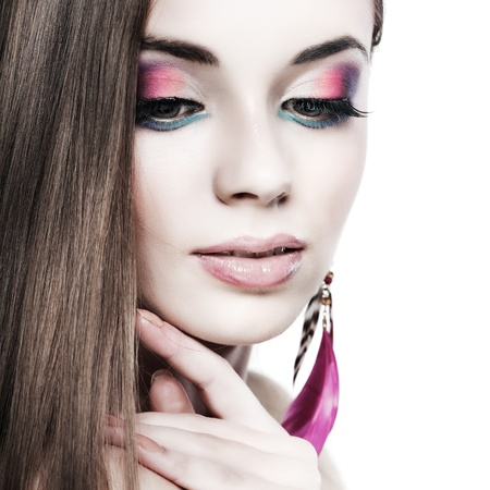 portrait elegant sexual woman  in fashion style in pink ear-rings from feathers photo