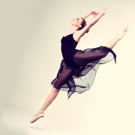 Beautiful ballet-dancer, modern style dancer posing on studio background Stock Photo