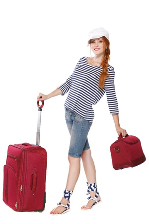 Beautiful redheaded tourist woman   Isolated on a white background photo