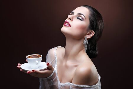 beautiful young girl  with  the cup of coffee photo