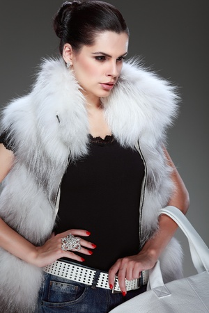 A photo of sexual beautiful girl is in fashion style is in fur clothes photo