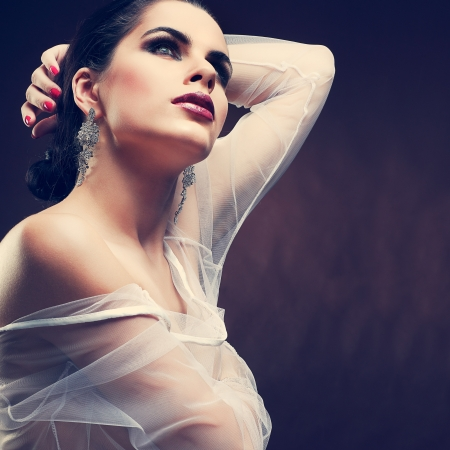 elegant sexual woman in white  clothes in fashion style photo