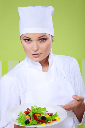 commercially: beautiful young chef woman prepare and decorating tasty food in kitchen