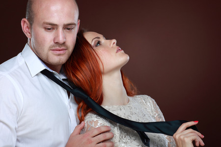 bald girl: Portrait of a young beautiful couple in studio Stock Photo
