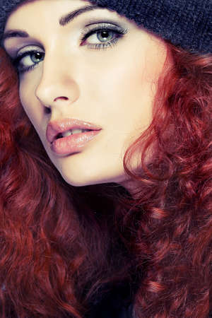Portrait of sexual beautiful redheaded girl in a sportwear, is in fashion style photo