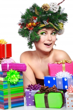 varicoloured: Christmas Woman. Beautiful New Year and Christmas Tree Holiday Hairstyle and Make up.