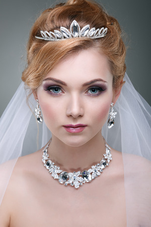 A photo of sexual beautiful girl in a wedding-dress is in fashion style. Wedding decorations photo