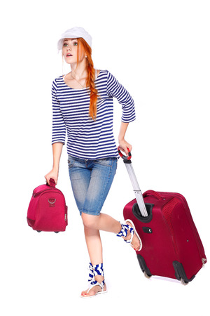 Beautiful redheaded tourist woman . Isolated on a white background photo