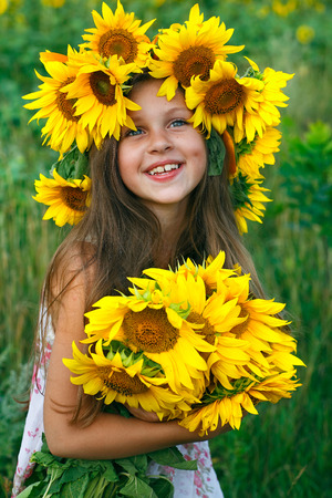 rest day: little glad girl with yellow on green a meadow, emotions, lifestyle