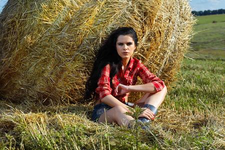 sex appeal: A beautiful brunette  is in the field