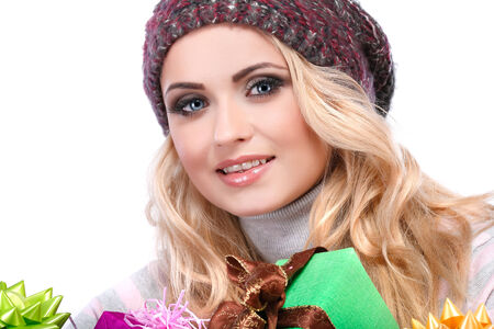 varicoloured: A photo of beautiful girl is in winter clothes with varicoloured gift boxes, isolated