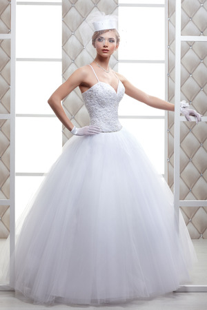 wedding accessories: A photo of sexual beautiful bride in a wedding-dress is in fashion style. Wedding decorations