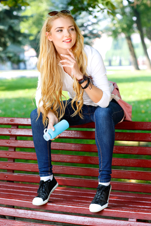 long hairs: Portrait of beautiful girl with light long hairs in a park. Stock Photo