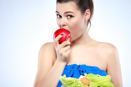 avid: Funny girl eating hamburger on grey background Stock Photo