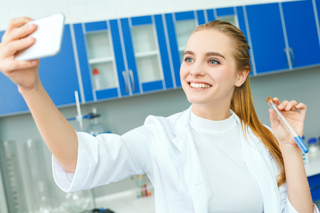 Young Chemistry Teacher In School Laboratory Workplace Writing