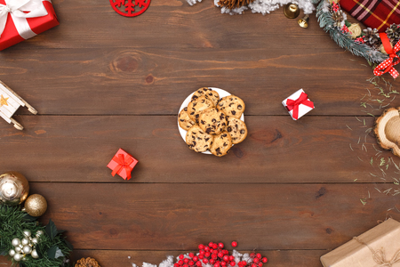 New Year. Plate of cookies ans gifts isolated on table top view close-up Stock Photo