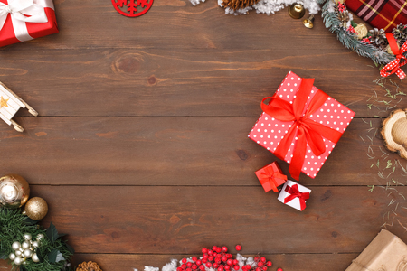 Merry Christmas. Different sized gifts isolated on wooden surface top view close-up