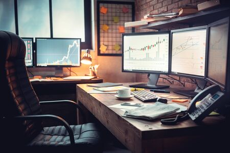 Workplace of trader. Ð¡harts and stock market in online networking. Banco de Imagens