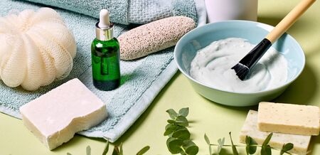 Serum oil in bottle with pipette and herbs ingredients