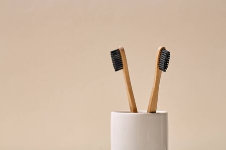 New eco and bamboo toothbrush with black nylon bristles Stock Photo